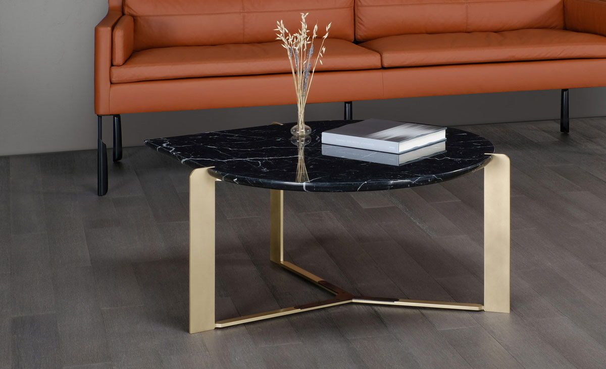 Dailyproductpick The Drop Cocktail Table By Skram Furniture Features An Undercut Stone Surface Supported By Matte Black Steel Surfaces Marble Top Coffee Table Table Furniture