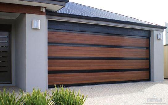 Wood garage doors house exteriors pinterest wood for Garage door wood look