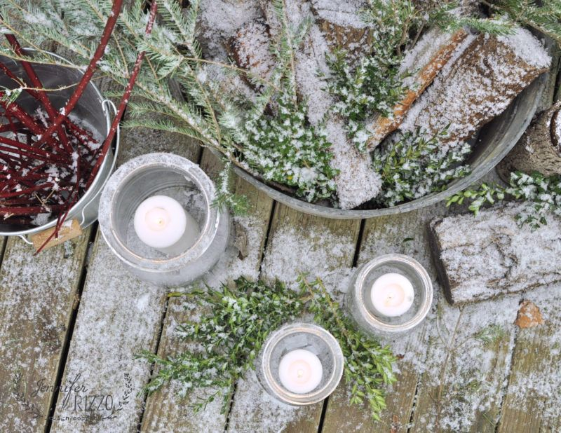 Snow and candles in pretty winter decor