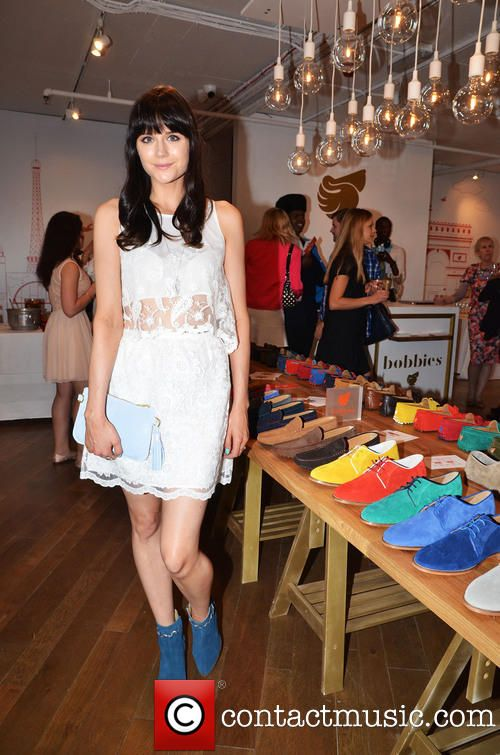Lilah Parsons @ Bobbies Launch Party in Covent Garden wearing a sleeveless, white top with matching skirt