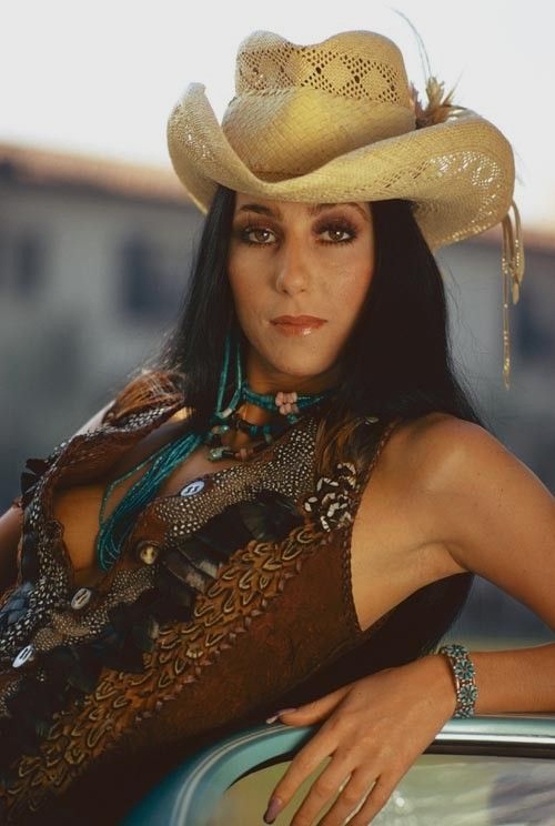 Young Cher= The makeup, hair, style, and attitude is just so pretty in this pic. Cher is a weirdo, but retro Cher is art.
