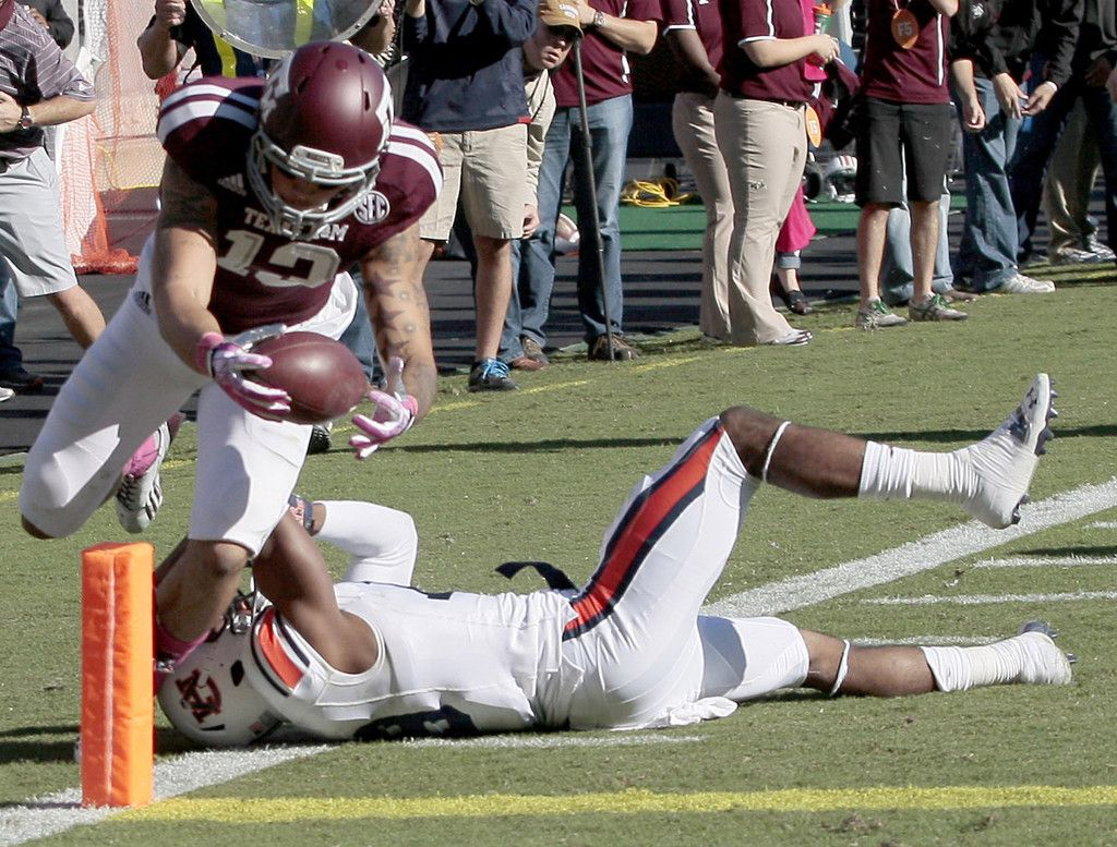 Mike Evans 13 Of The Texas A M Aggies Dives Over Ryan White 19 Of The Auburn Tigers For A Touchdown Reception On Football Pictures Auburn Tigers College Team