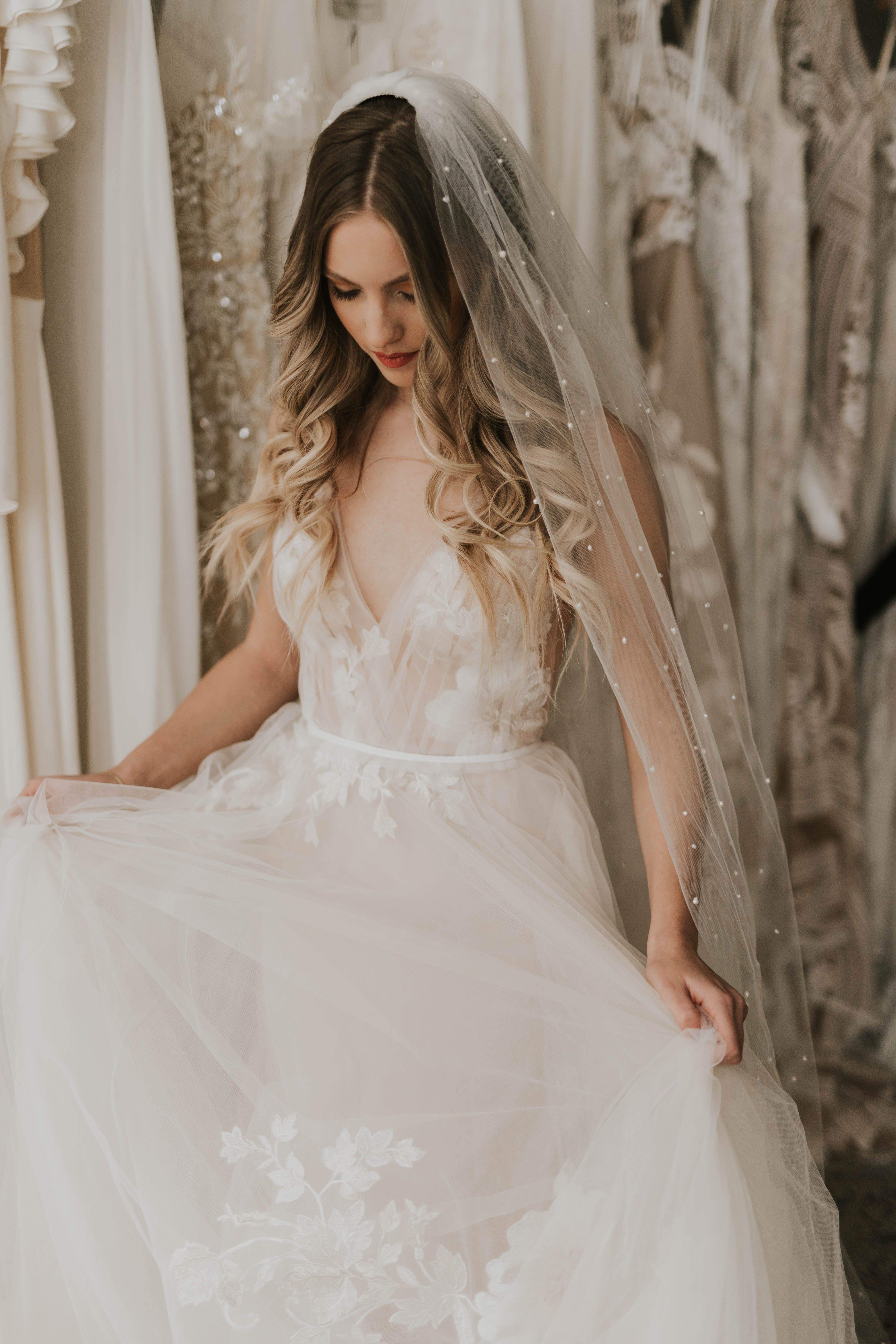 Lainie by Willowby | Available at Minneapolis, Dallas, Denver, Miami, Seattle + Portland a&bé bridal shops | Tulle aline wedding dress with large floral lace dispersed throughout dress | Modern Bridal Shop | Modern Bride | Cool Girl Bridal | 2019 Wedding Dresses | Photos by: Nicole Castonguay | #willowby #watters #aandbebridalshop #bridalshops