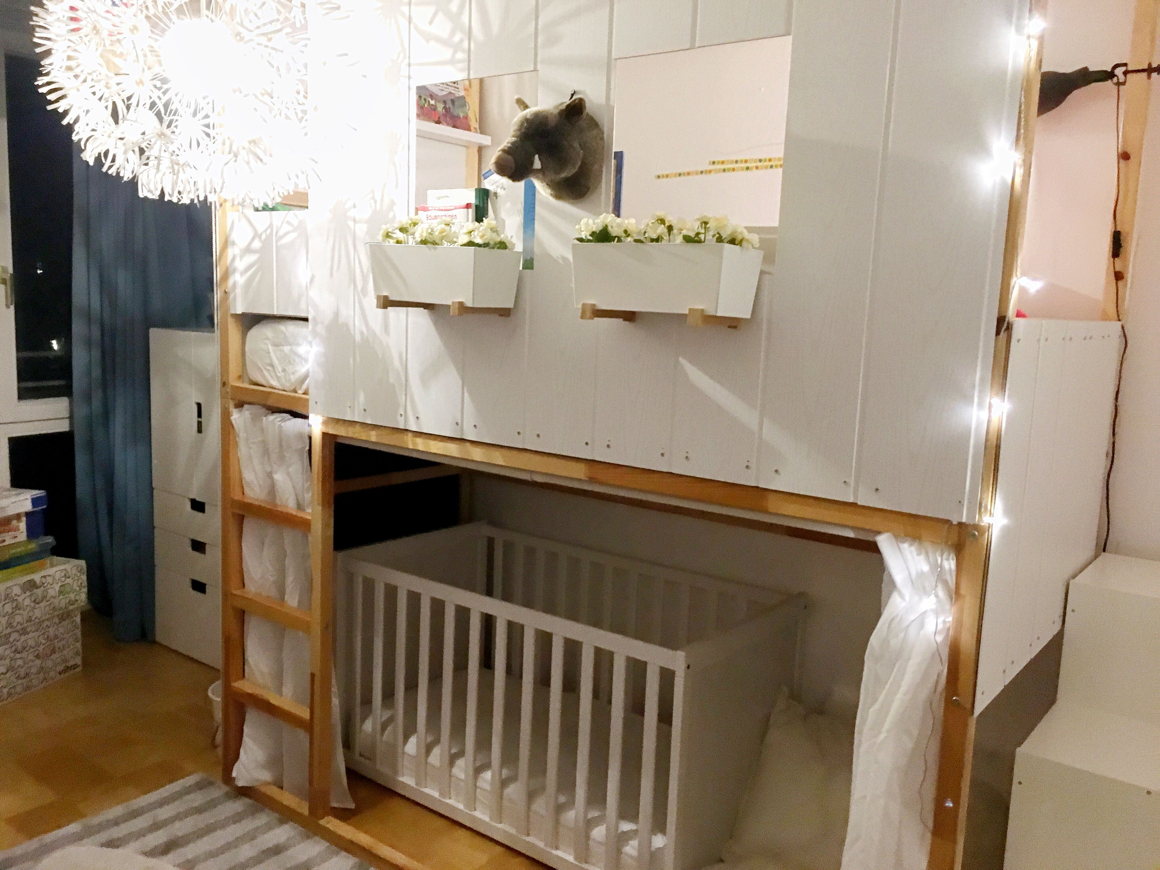 high bed / bunk bed with baby cot. ikea kura hack with two kura's as