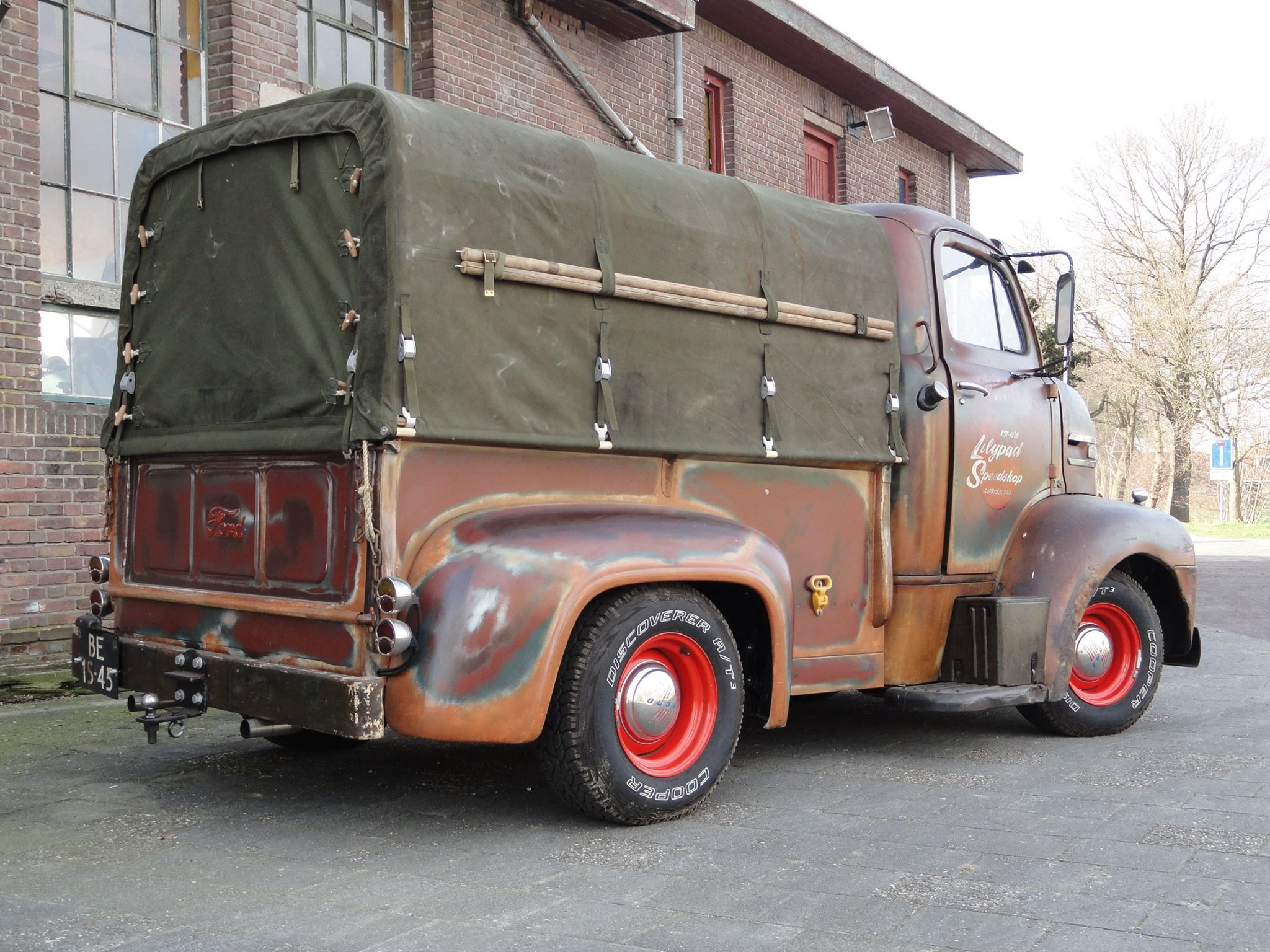 Ford coe with a custom truck bed on the back with a canvas topper pic