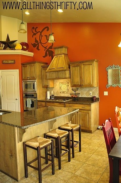 Light Orange Kitchen Walls orange kitchen walls and light wood cabinets | our future home