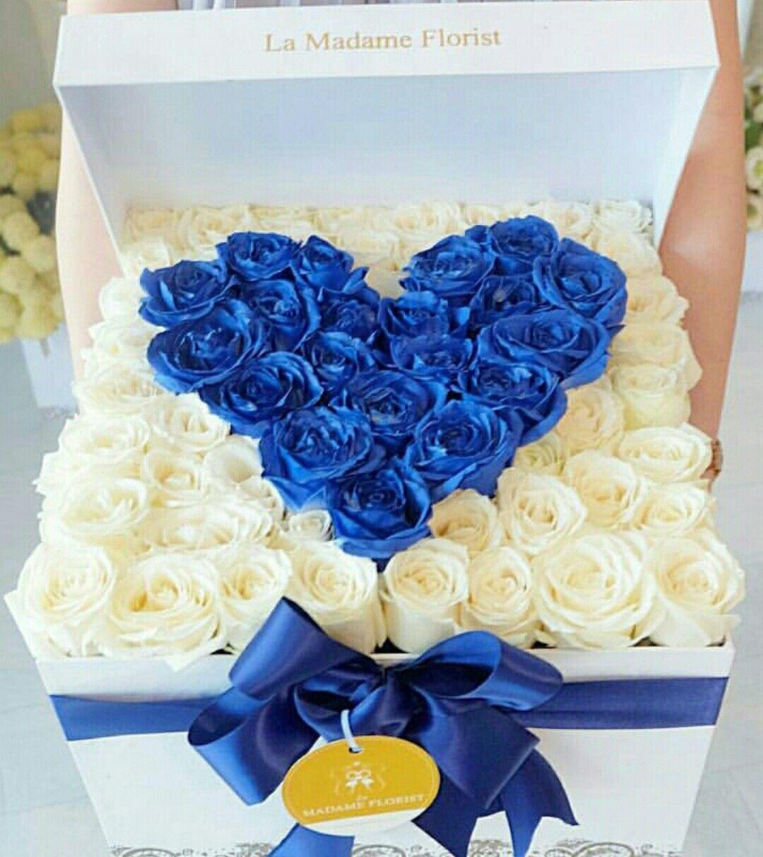 Box of flowers white roses blue roses in heart shape