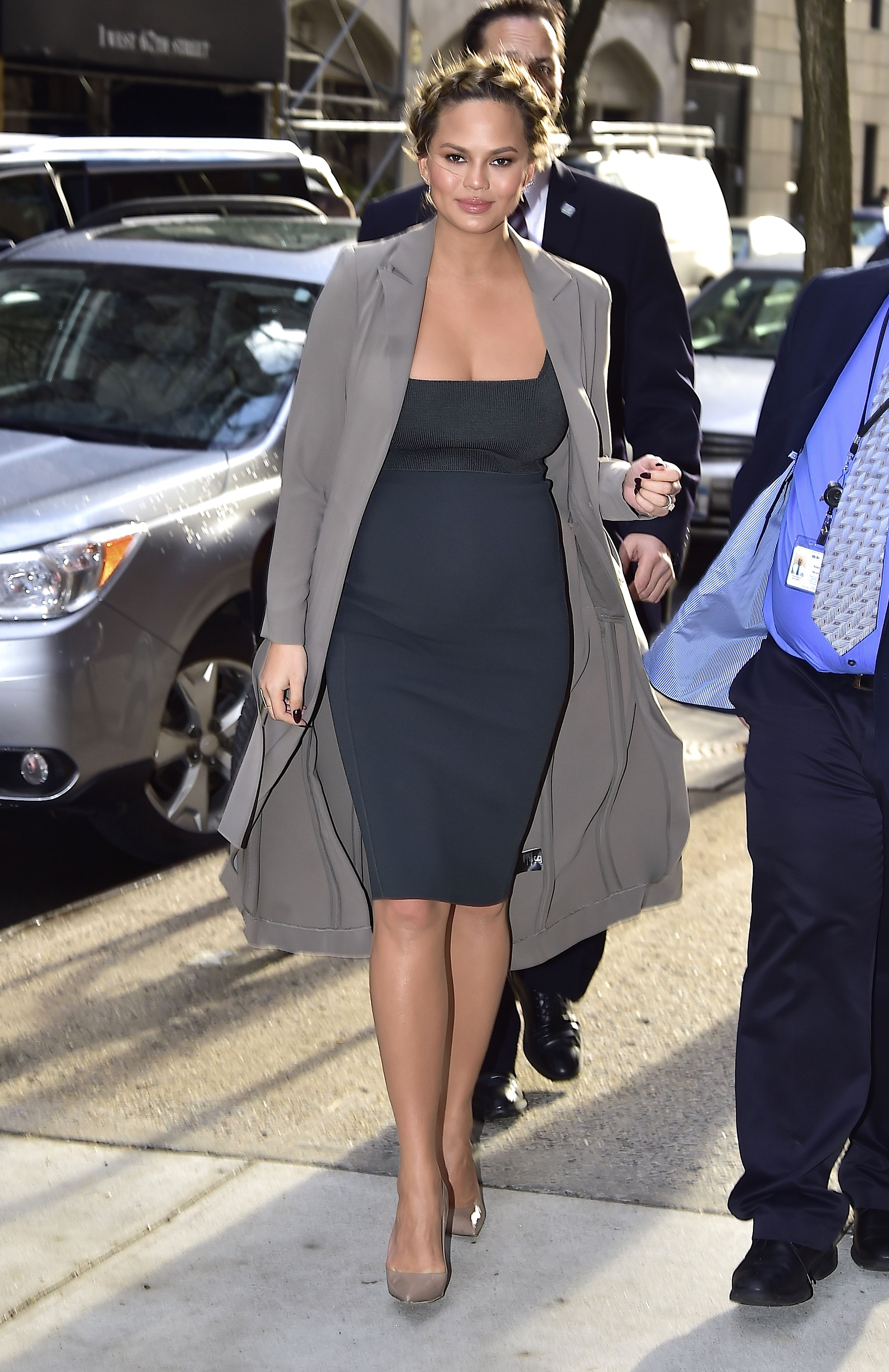 d3aa02b7e Pregnant Chrissy Teigen sports three outfits while promoting cookbook