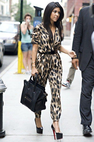 Kourtney Kardashian wears a pant suit