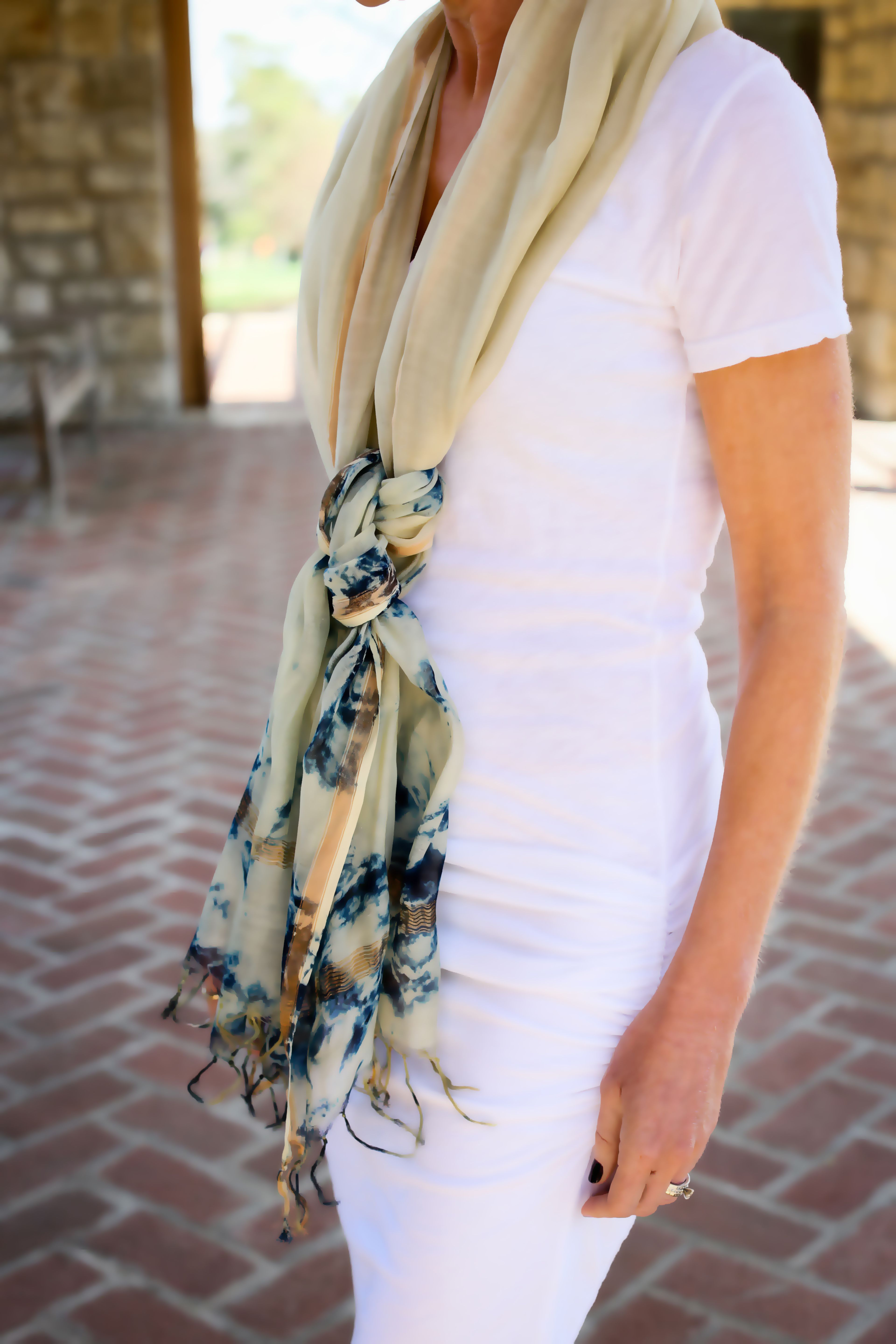 Style Tip: Try double knotting the Gwynn Marble Print Scarf and then tug at the knots to add volume.   www.lionsinfour.com  Lions in Four Style Guide