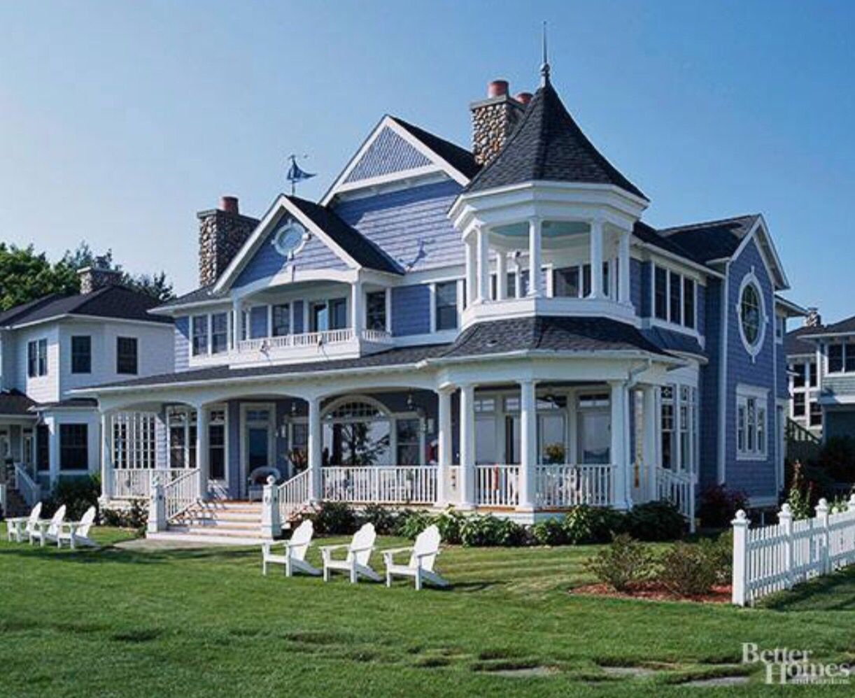 This Is A Victorian House Because Of The Tower With Many Balconies