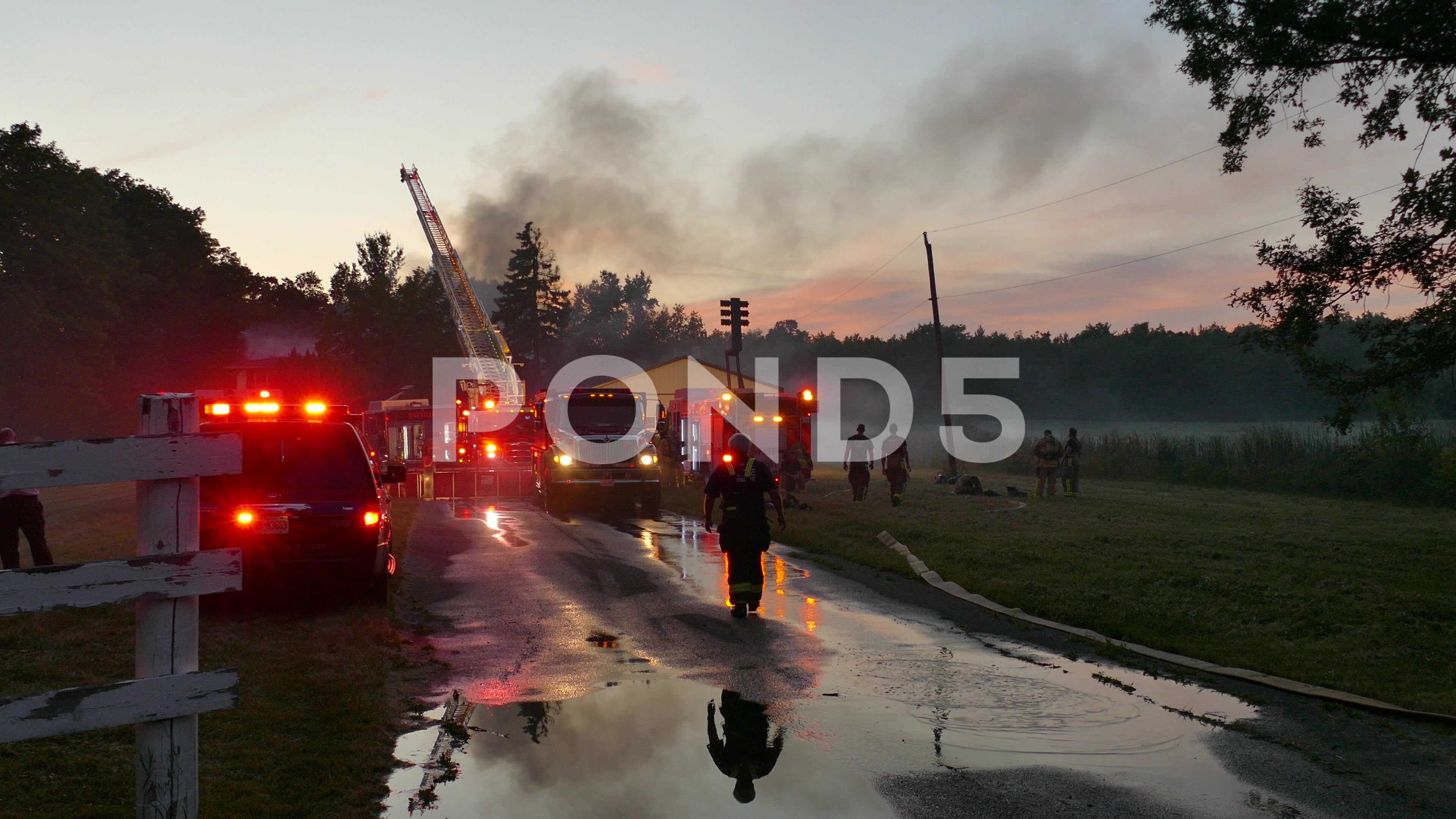 Fire department working at fire in the evening stock