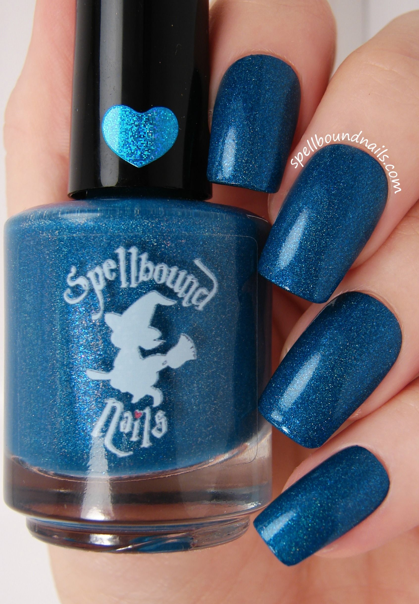 Twilight's Last Gleaming: is a faded royal blue holographic with a chunky blue shimmer. This polish dries to a matte like finish so a quality top coat is a must.