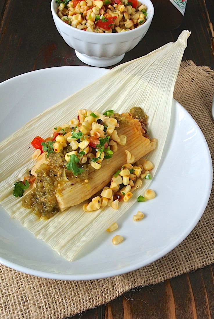 Pulled Pork Tamales Pulled Pork Tamales. Delicious slow cooked pulled pork along with masa dough is wrapped in corn husks and steamed. Best served with homemade quick & easy corn salsa.