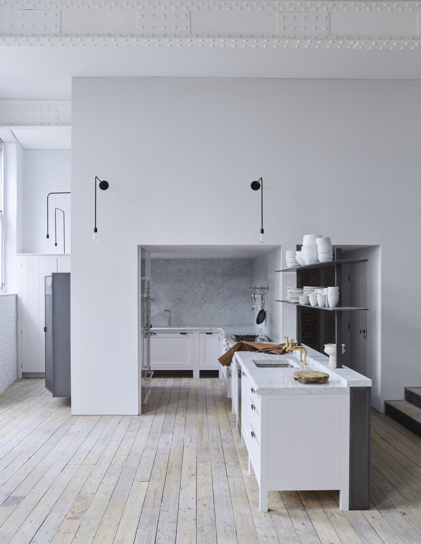 16 Favorite Solid Marble Kitchen Backsplashes, for Maximum Drama #plainenglishkitchen Seth Stein Architects revitalized a former schoolhouse in London by adding a Plain English kitchen, and clad two entire walls in marble. Photograph courtesy of Plain English; see the full kitchen in Kitchen of the Week: Plain English Goes Contemporary in a Converted London Schoolhouse. #plainenglishkitchen