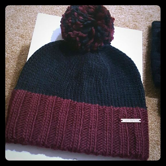 NEW Michael Kors Beanie New! Cute! Has a pompom ontop. ASK FOR DISCOUNTED SHIPPING! Michael Kors Accessories Hats