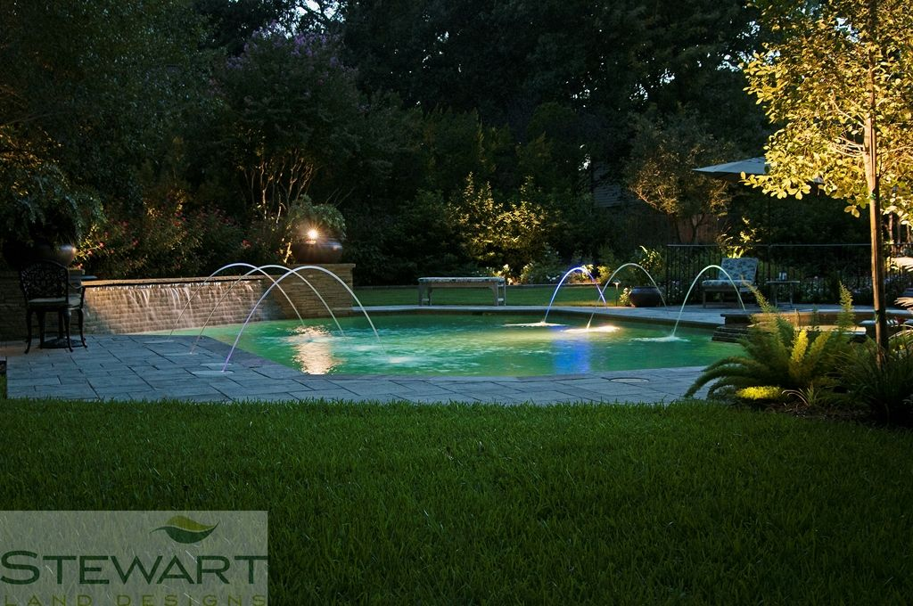 Make the area surrounding the pool friendly too with potted plants and plenty of comfy seating. #StewartLandDesigns