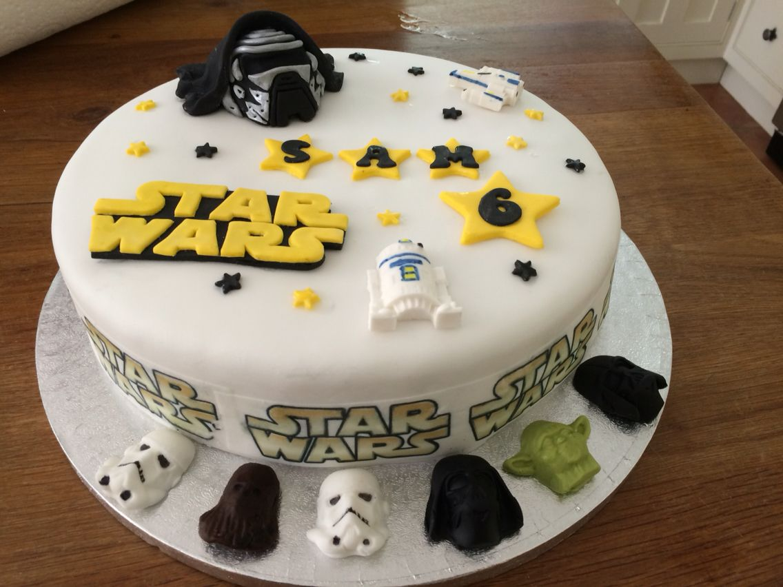 Star Wars cake Plain iced cake from waitrose and cake toppers from
