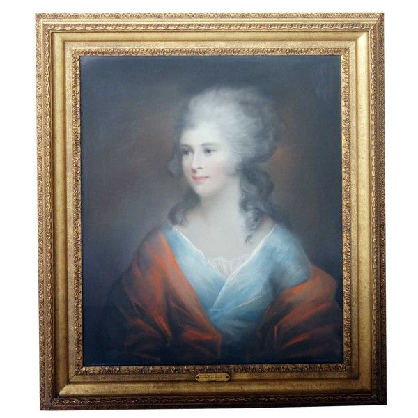 English School Pastel Portrait of a Young Lady circa 1780 Unsigned. A half length portrait of a seated lady wearing a blue dress with a red wrap. Housed in an earlier gilt frame with an artist's name plate.