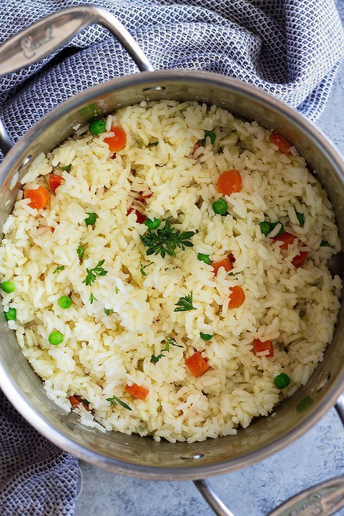 This Easy Rice Pilaf with Carrots and Peas is a staple recipe everyone should learn how to make. It's so easy to make, goes great with so many dishes, and you can easily make it your own. #easyricepilaf This Easy Rice Pilaf with Carrots and Peas is a staple recipe everyone should learn how to make. It's so easy to make, goes great with so many dishes, and you can easily make it your own. #easyricepilaf This Easy Rice Pilaf with Carrots and Peas is a staple recipe everyone should learn how to mak #easyricepilaf