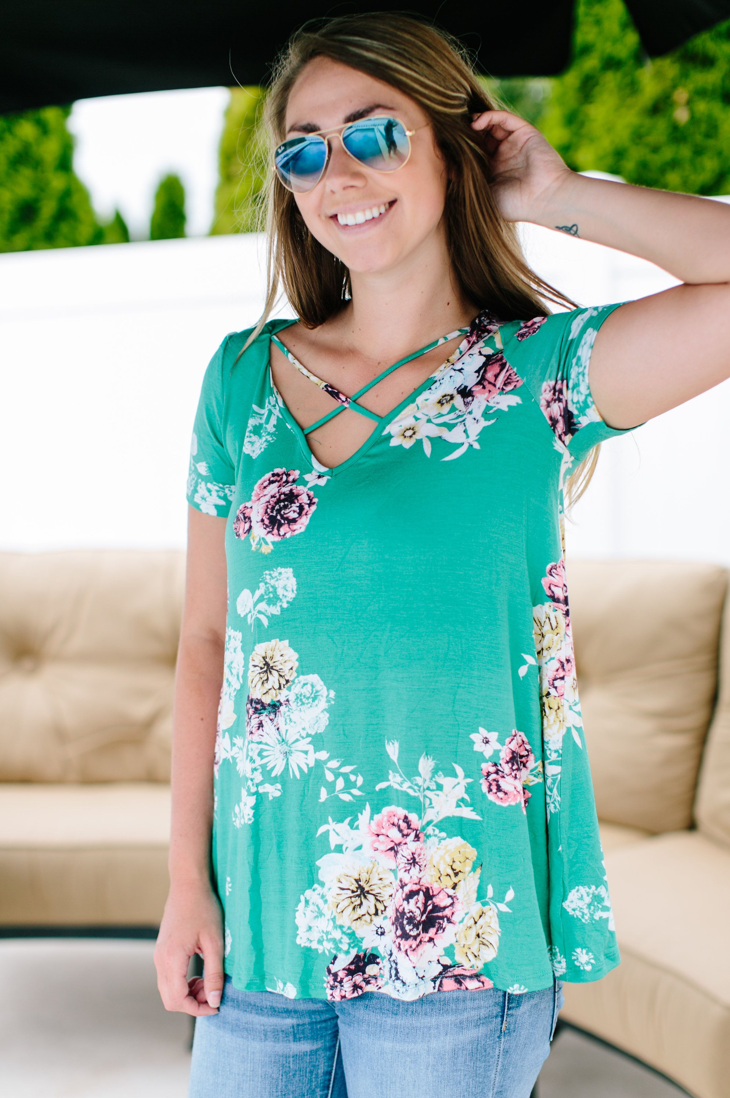 Our favorite front crisscross detail is back and in floral this