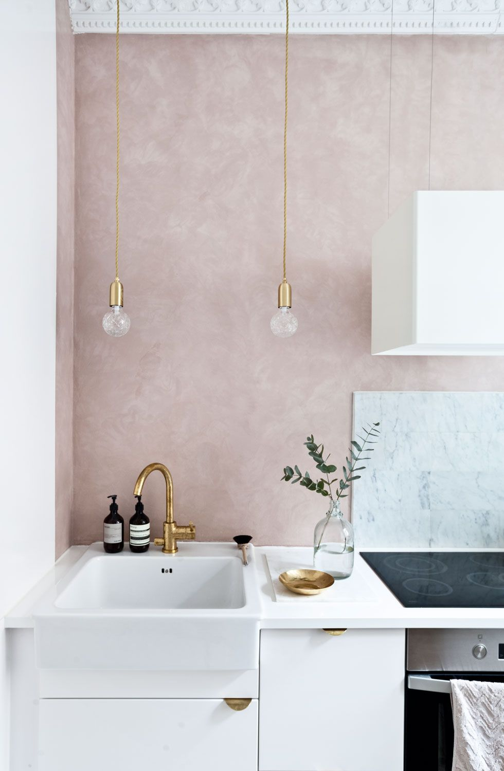 Gravity Home: White kitchen with a soft pink wall