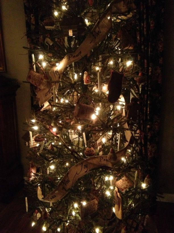 primitive christmas tree with burlap ribbon garland and silicone tipped string lights