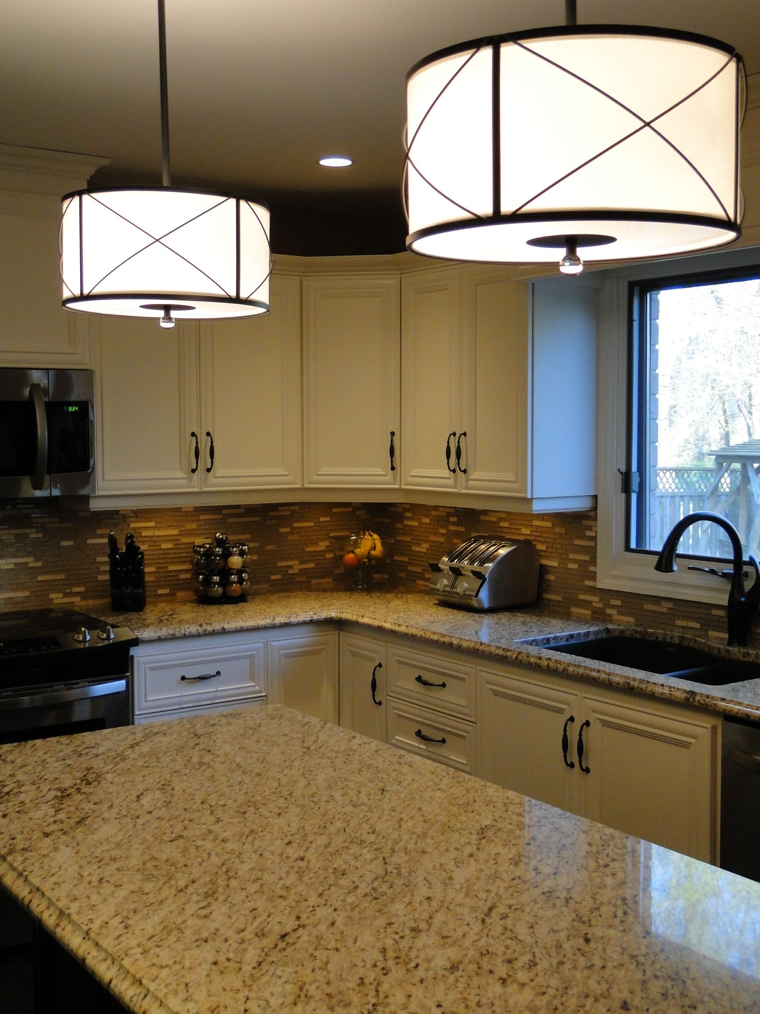 drum pendant lights over the kitchen island could put