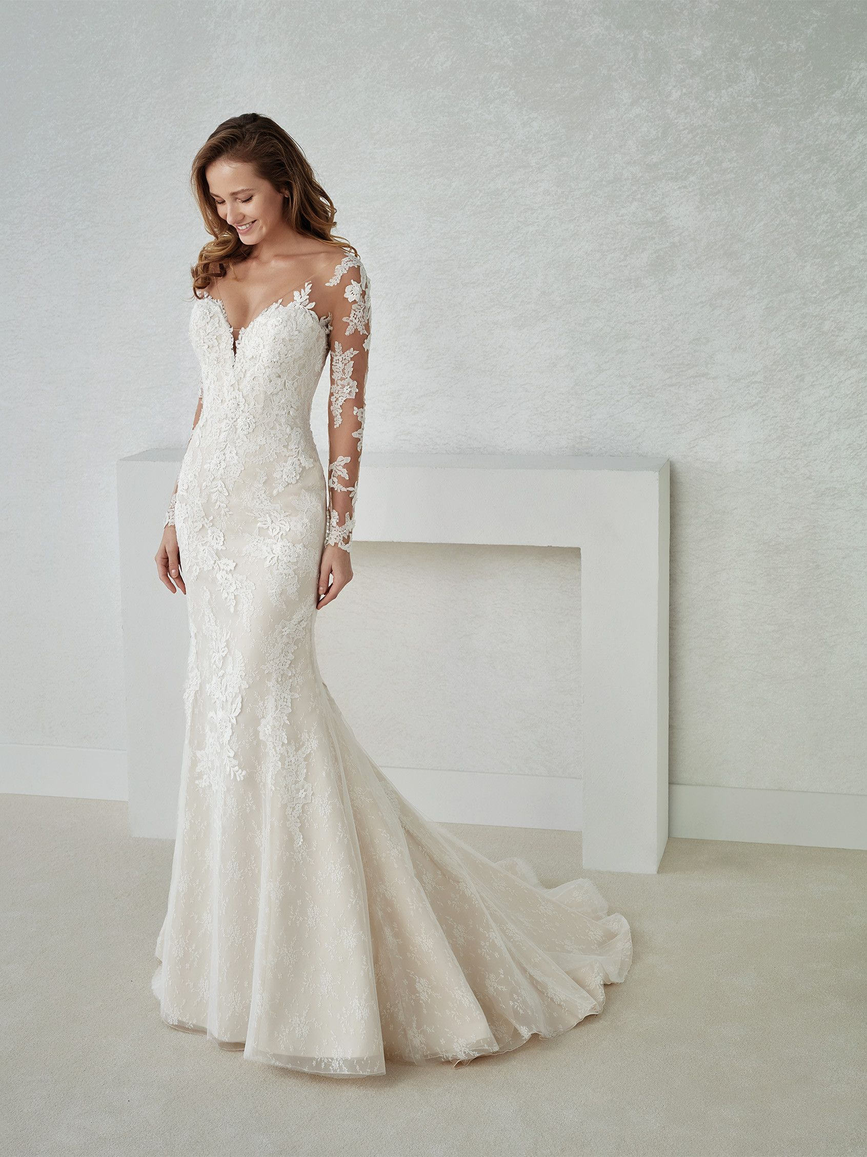 ccfec3b45241 Sensual low waist mermaid wedding dress in lace and embroidered tulle. A  design with a sweetheart illusion neckline and V-shaped back that creates a  ...
