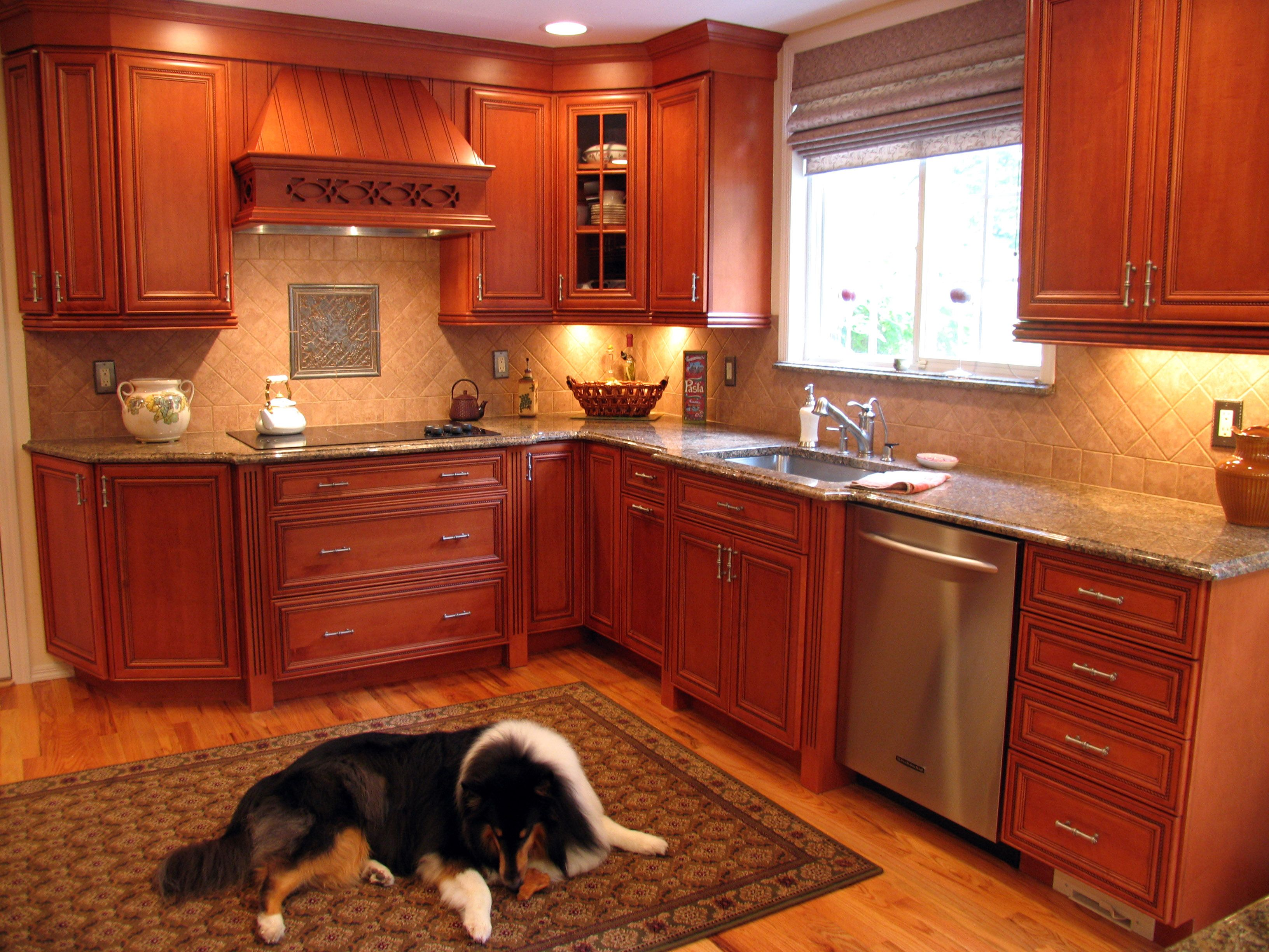 amber maple kitchen cabinets with an og edge granite countertop