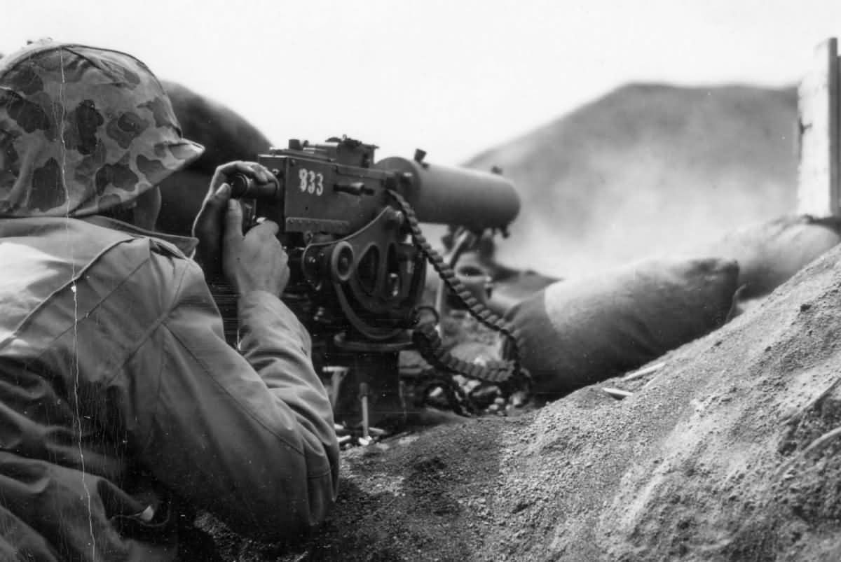 5th Marine Division .30 caliber machine gunner fires in support of an assault on Japanese positions on February 19 1945.