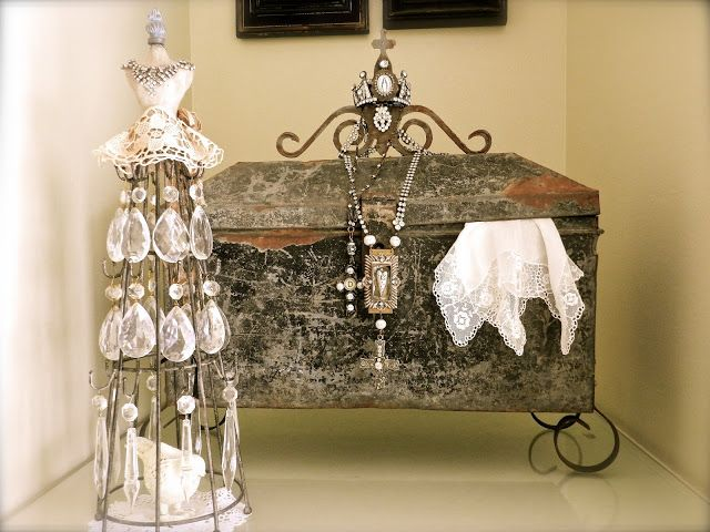 A re-purposed metal tool box embellished with forged iron legs and  crown