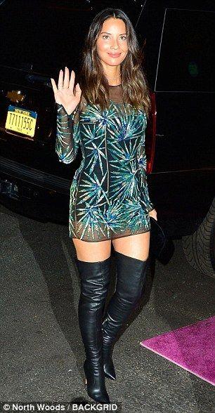 MTV VMAs Olivia Munn glitters in sheer mini-dress and thigh-high boots