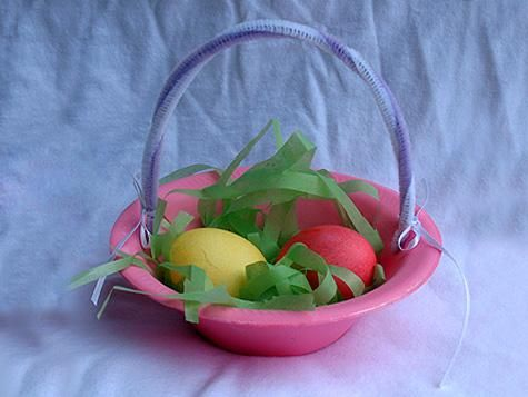 Cute miniature Easter basket is perfect for any Easter party. Make enough for each party guest and fill with goodies. You'll need styrofoam bowls, chenille stems, ribbon, paint and tissue paper. #Crafts #Kids #Party #Bowl
