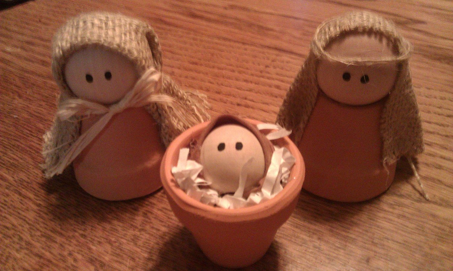 """•❈• Nativity Craft ...  Handmade nativity includes baby Jesus, Mary and Joseph.  Clay pots are left natural. Burlap is used for headdress.  Made from 1 1/2"""" clay pots 1 1/2 """" wooden balls are used for the heads of Mary and Joseph. 1"""" wooden balls form baby Jesus. Height is approximately 3""""."""