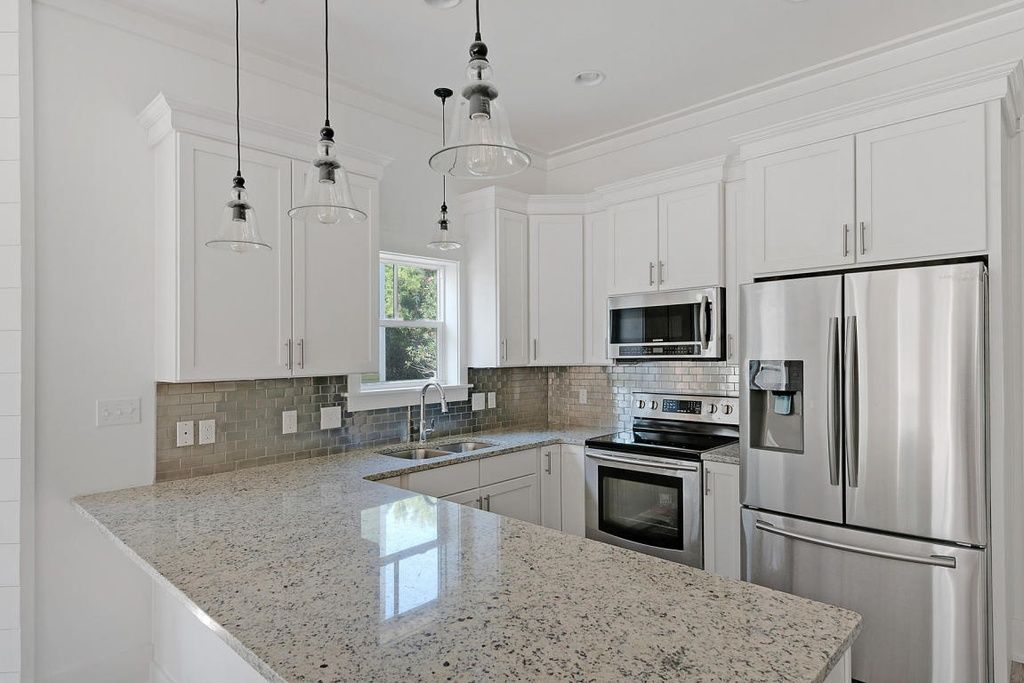 traditional kitchen with pendant light pottery barn rustic glass rh pinterest com