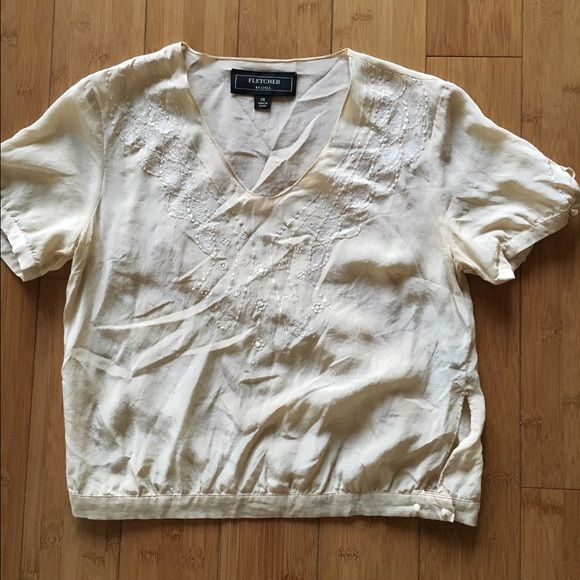 Cream colored crop top with flower embroidery Size xs cream colored crop top with flowers embroidered into the neck line. Fletcher Tops Crop Tops