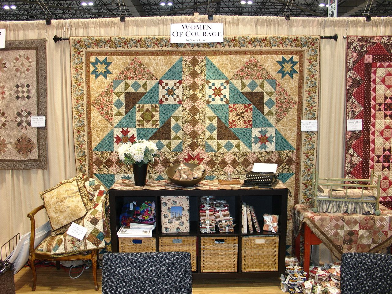 BEAUTIFUL! Women of Courage Quilt at the Windham booth at quilt market 2012.