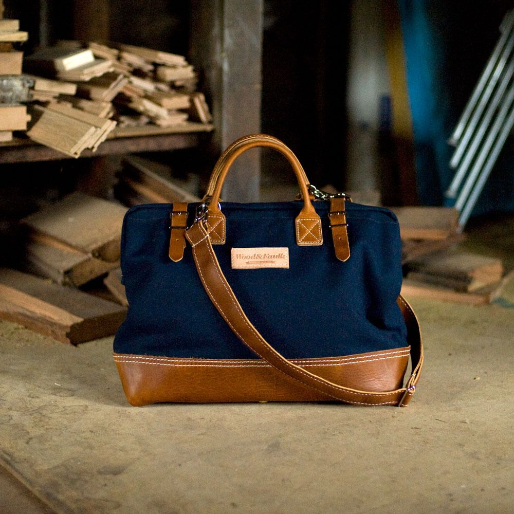 Bag is built with Heavy duty 16oz, navy cotton canvas and a soft, honey-colored leather on the bottom, handles and straps. This leather is soft, like a well-worn baseball glove.