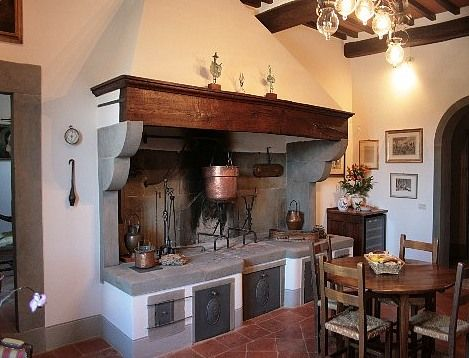 an italian country kitchen with the open fireplace. | country farm