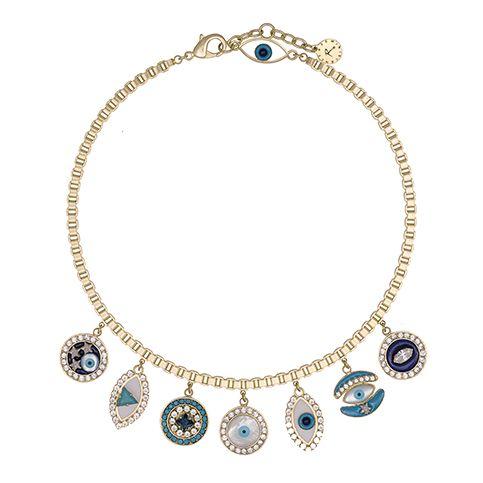 Tour de cou en m�tal dor�, embelli de petits pendants compos� d'un oeil en nacre et de petites mosa�ques compos�es d'�mail et de cristaux Swarovski.