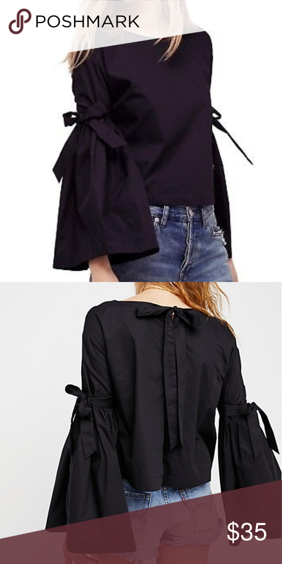 f39b2a82af74 Free People Poplin Bell Sleeve Blouse Black cotton with pleated bell sleeves.  Adorable and pretty true to size. Ties at neck in back.