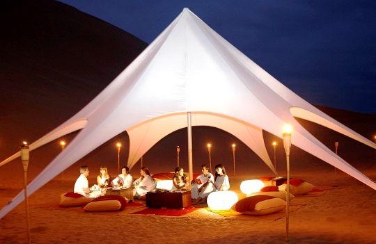 Paracas, Peru. Tent dinner in desert. TRAVEL