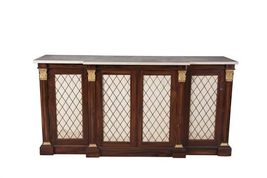 A REGENCY ROSEWOOD RECTANGULAR BREAKFRONT SIDE CABINET, with white marble top above four brass wi
