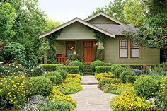 How To Convert Your Lawn Into a Garden - Houston Bungalow Garden - Southernliving. David Morello hasn't been led away in cuffs by theneighborhoodlawn police, but it's only a matter of time. Flouting the holiestconvention of accepted suburban landscape design, he rippedout the grass in front of his Houston bungalow and filled the40- by 60-foot space with waves of flowers and shrubs.If you've ever thought about converting yourfront lawn into a garden but aren't quite ready to go in…
