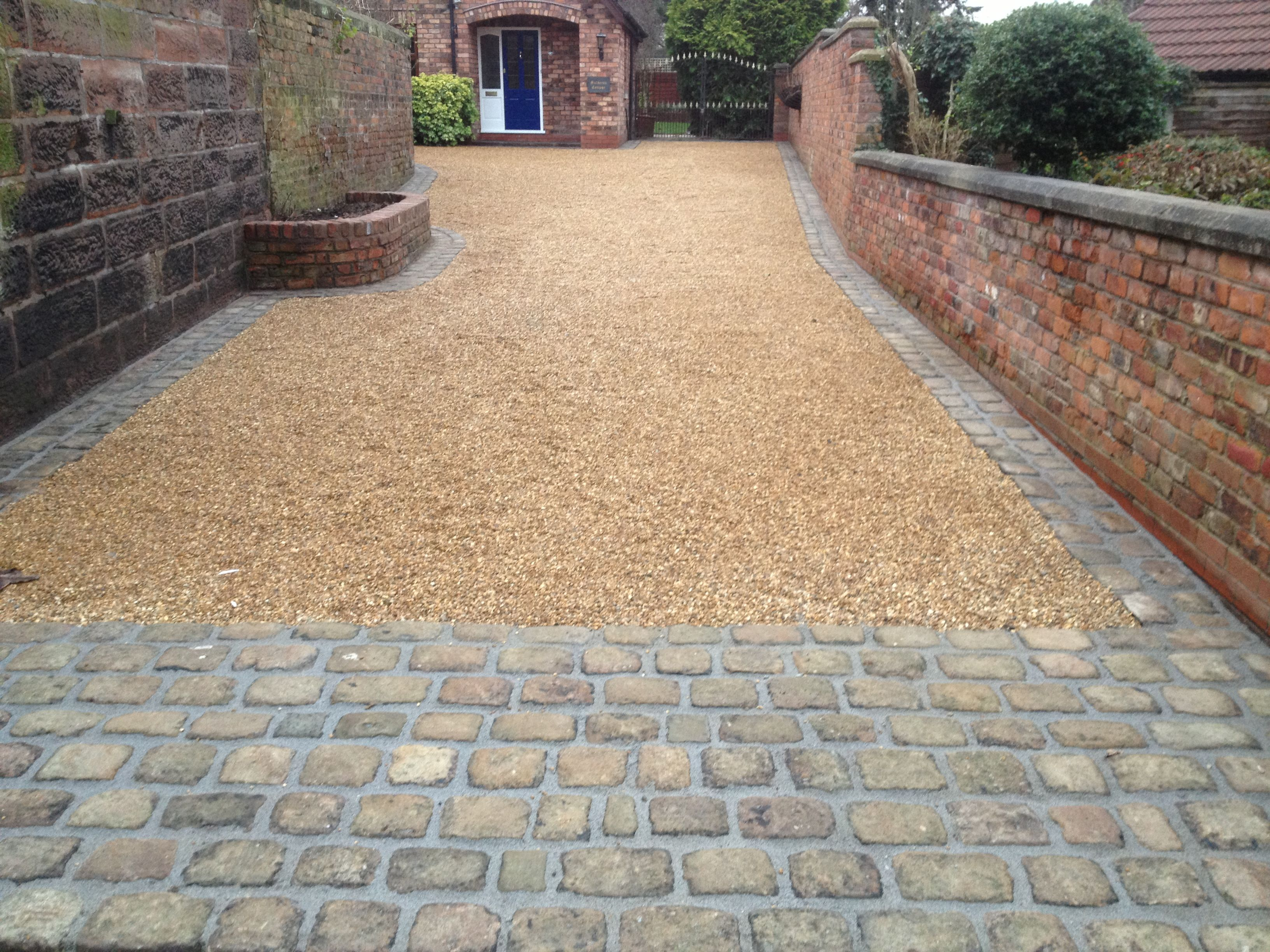 Gravel driveway with gravel stabilizers to keep gravel in for Sloped driveway options