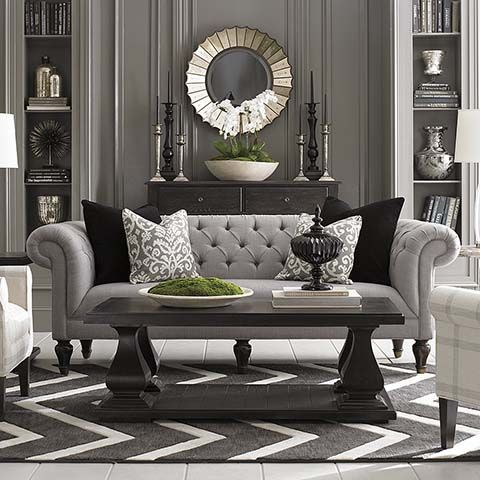 The classic gray sofa and black table plus the decor including the
