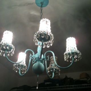 Repurpose an old chandelier by spray painting it and adding crystal shades. Turned out super fun!