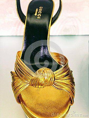 c452ca74bdf Gucci golden platform women`s shoes on display at Saks Fifth Avenue store  in Toronto