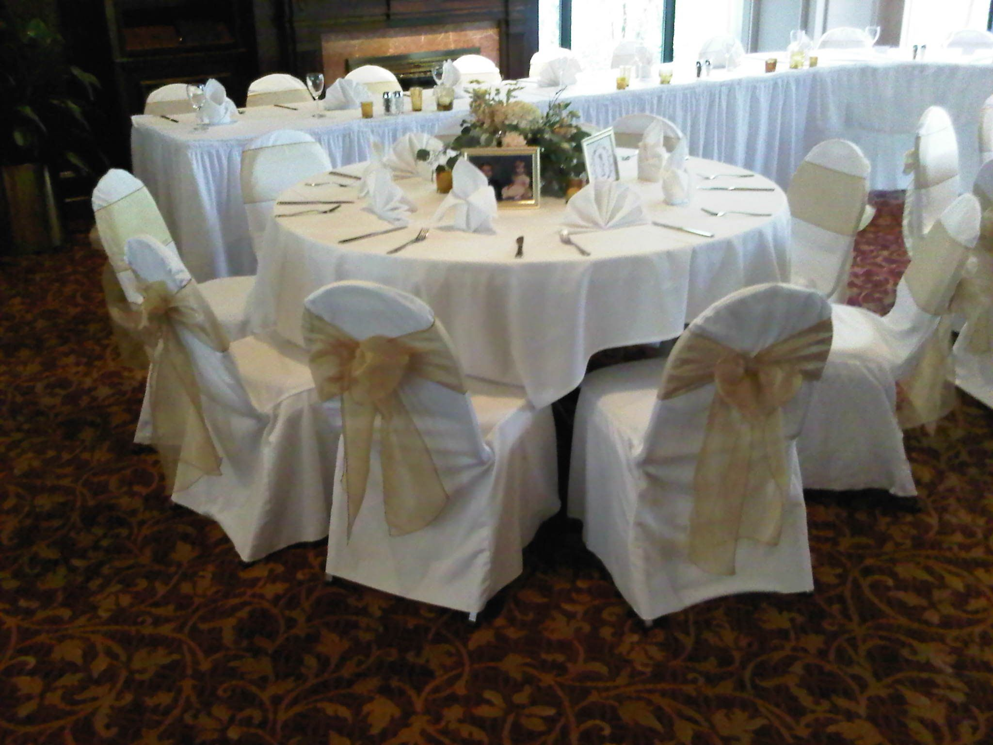 Ivory Chair Covers with Gold Organza Sashes traditional bow at